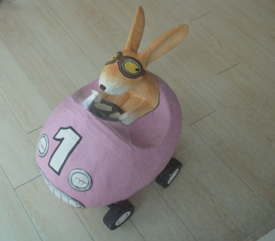 Easter bunny in race car